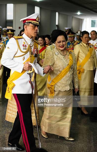 Thailand's Queen Sirikit and Crown Prince Maha Vajiralongkorn follow King Bhumibol Adulyadej as he returns from The Grand Palace to Siriraj Hospital...