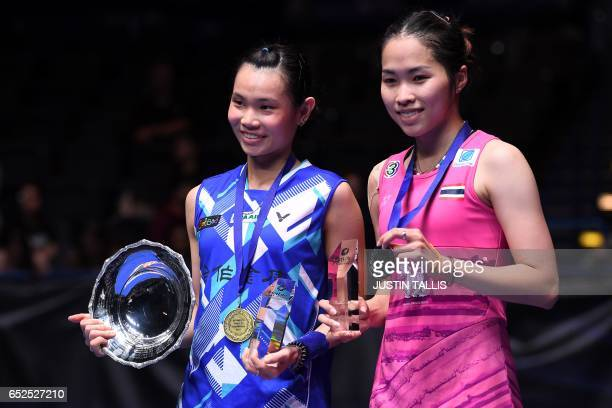 Thailand's Ratchanok Intanon and Taiwan's Tai Tzu Ying pose with their trophies and medals after the women's singles final match at the All England...