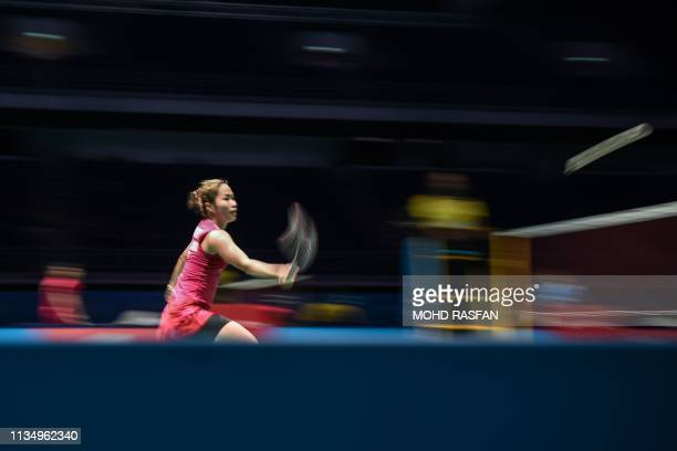 Thailand's Ratchanok Intanon hits a return against Taiwan's Tai Tzu Ying during their women's singles quarterfinal match at the Malaysia Open...