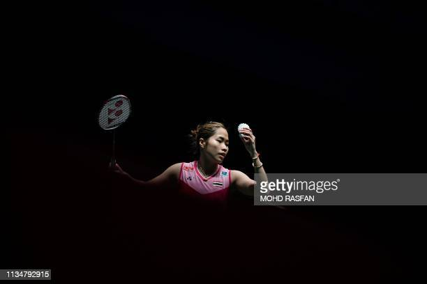 TOPSHOT Thailand's Ratchanok Intanon prepares to serve against Zhang Beiwen of the US during their women's singles match at the Malaysia Open...
