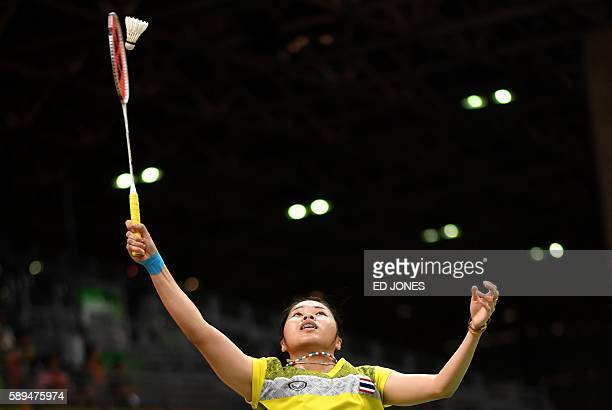 TOPSHOT Thailand's Ratchanok Intanon returns to Hong Kong's Yip Pui Yin during their women's singles qualifying badminton match at the Riocentro...
