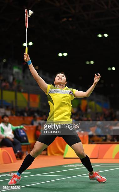 Thailand's Ratchanok Intanon returns to Hong Kong's Yip Pui Yin during their women's singles qualifying badminton match at the Riocentro stadium in...