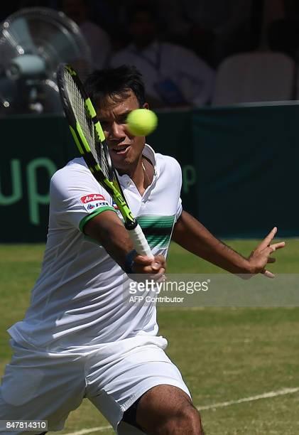 Thailand's Ratiwana Sanchai returns the ball to Pakistan's Muhammad Abid and Shahzadat Khan during their Davis Cup AsiaOceania GroupII Tennis doubles...