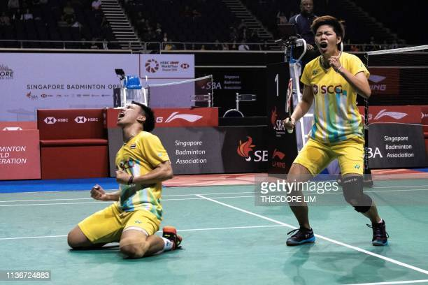 Thailand's Sapisree Taerattanachai and Dechapol Puvaranukroh celebrate after defeating China's Zheng Siwei and Huang Yaqiong during their mixed...