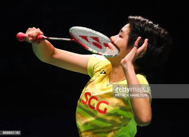 Thailand's Sapsiree Taerattanachai hits a return with partner Dechapol Puavaranukroh during the mixed doubles Sudirman Cup match against Chae Yoo...