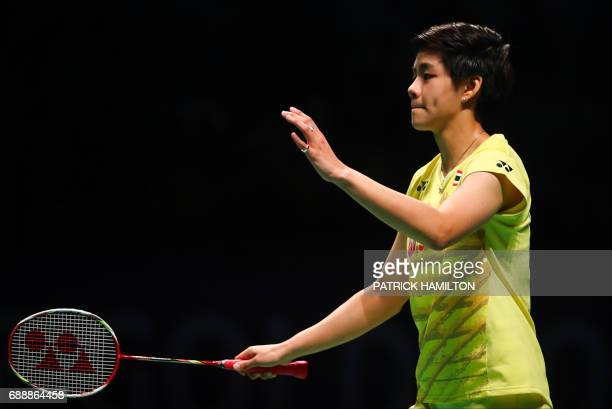 Thailand's Sapsiree Taerattanachai reacts to a point with partner Dechapol Puavaranukroh during the mixed doubles Sudirman Cup match against Chae Yoo...