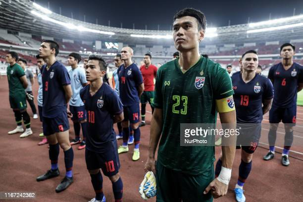 Thailand's Siwarak Tedsungnoen and teammates applaud fans after the match during FIFA World Cup 2022 qualifying match between Indonesia and Thailand...