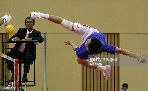 Thailand's Supachai Maneenat returns a shot to the Philippines during their men's quarter final match on day three of the ISTAF Super Series at ITE...
