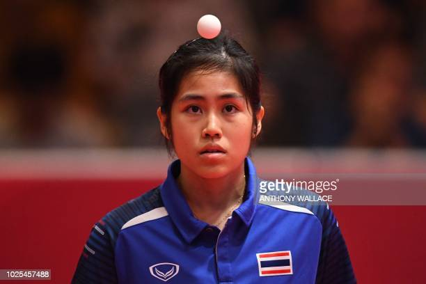 Thailand's Suthasini Sawettabut eyes the ball as she plays Hong Kong's Lee Ho Ching during their round 16 table tennis match at the Asian Games in...