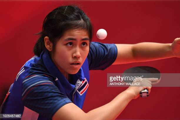 Thailand's Suthasini Sawettabut hits the ball as she plays Hong Kong's Lee Ho Ching during their round 16 table tennis match at the Asian Games in...