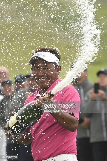 Thailand's Thongchai Jaidee sprays champagne after winning the 100th French Golf Open on July 3 2016 at Le Golf National in Guyancourt near Paris /...
