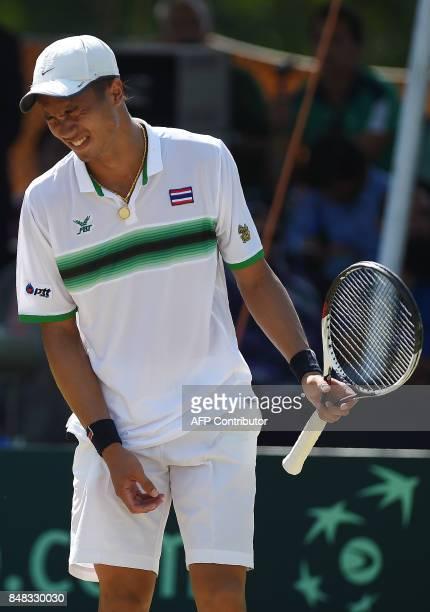 Thailand's Trongcharoenchaikul Wishaya reacts during his Davis Cup AsiaOceania GroupII Tennis singles final match against Pakistan's Aisam Qureshi at...