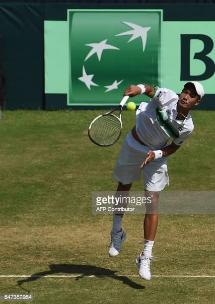 Thailand's Wishaya Trongcharoenchaikul serves during his Davis Cup AsiaOceania GroupII singles tennis match against Pakistan's Aqeel Khan at the...