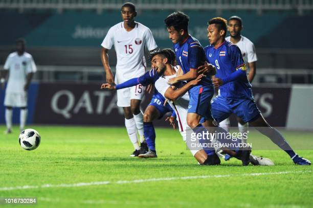 Thailand's Worachit Kanitsribumphen vies for the ball during the men's football Group B match between Qatar and Thailand at the 2018 Asian Games in...