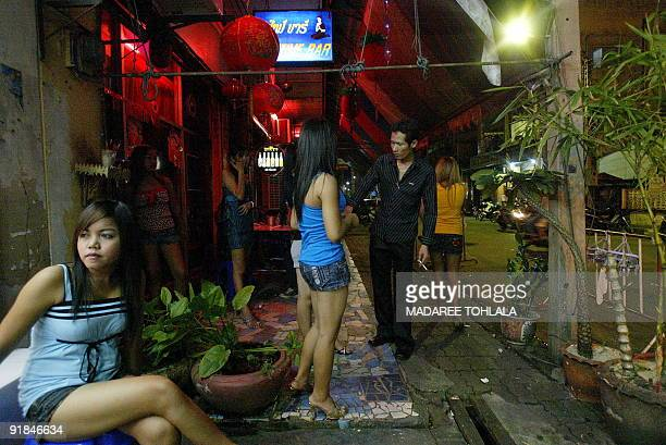 ThailandsouthprostitutionMalaysia by Rachel O'BRIEN In this picture taken on August 18 Thai bar girls wait for customers outside a bar in Sungai...