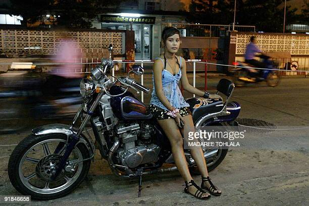 ThailandsouthprostitutionMalaysia by Rachel O'BRIEN In this picture taken on August 18 a Thai bar girl waits for customers outside a bar in Sungai...