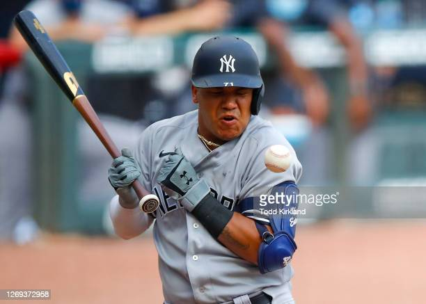Thairo Estrada of the New York Yankees is hit by a pitch in the fifth inning of game one of the MLB doubleheader against the Atlanta Braves at Truist...