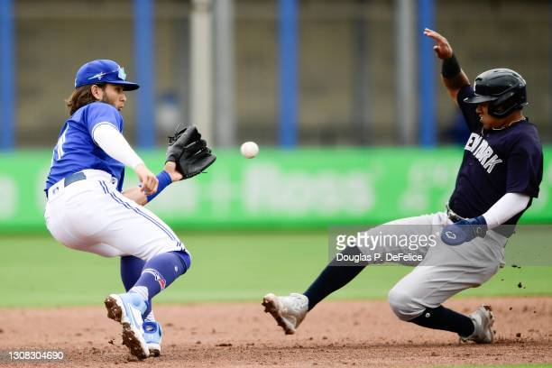 Thairo Estrada of the New York Yankees steals second base as Bo Bichette of the Toronto Blue Jays covers during the sixth inning of a spring training...