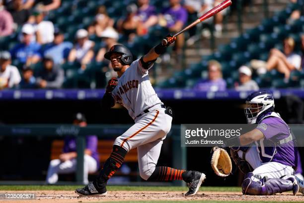 Thairo Estrada of the San Francisco Giants hits a solo home run during the fourth inning against the Colorado Rockies at Coors Field on September 6,...