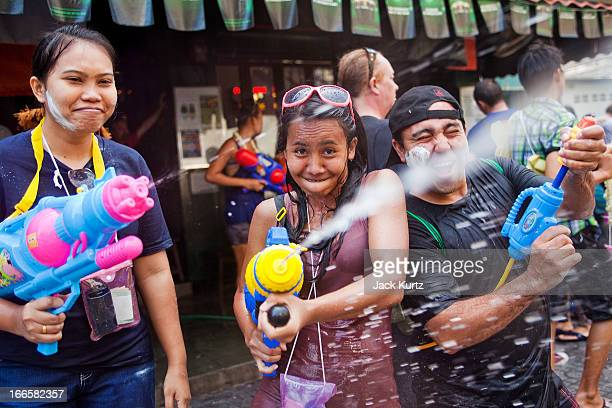 Thais and tourists have a waterfight on Sukhumvit Soi Nana as part of the Songkran water festival on April 14 2013 in Bangkok Thailand The Songkran...
