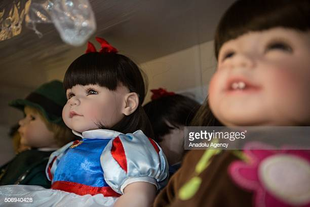 Thai's 'Child Angel' doll or 'Luuk thep' in Thai are displayed in a shop in the outskirt of Bangkok on January 26 2016 They were popularised by...