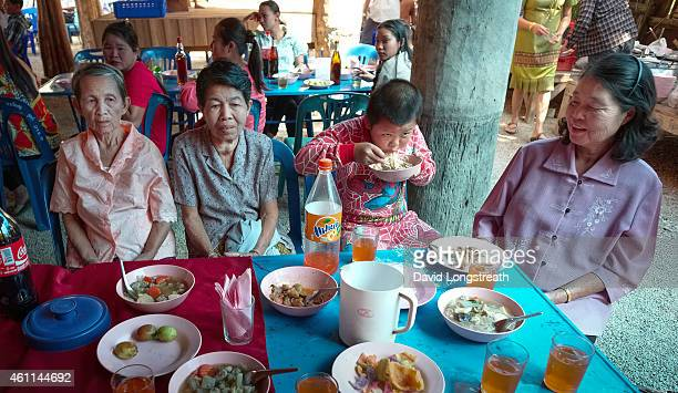 Thais gather during ceremonies at the wedding of Kanokporn and Montri Thi in Ta Par Mok Thailand
