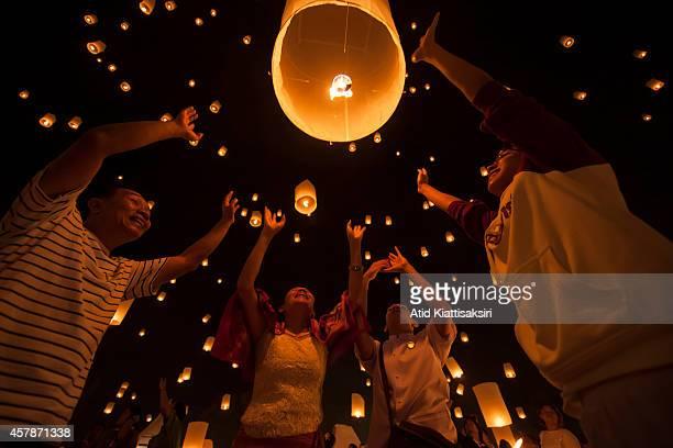Thais launch a Khom Loi during the Yi Peng Festival at Lanna Dhutanka