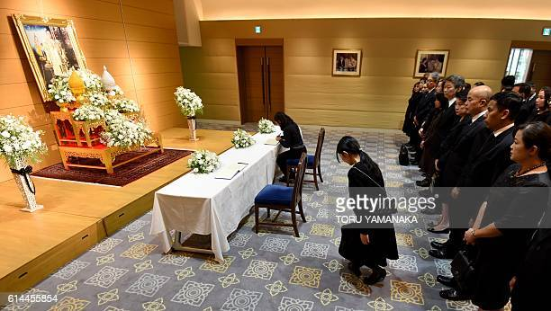 Thais living in Japan gather in front of an altar to pay their respects to the late Thai King Bhumibol Adulyadej at the Thai Embassy in Tokyo on...