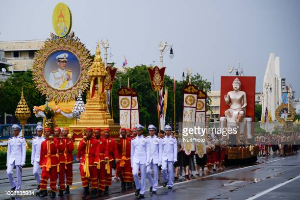 Thais parade in a procession comprising symbols of Buddhism to mark Asanha Bucha Day in Bangkok Thailand 22 July 2018