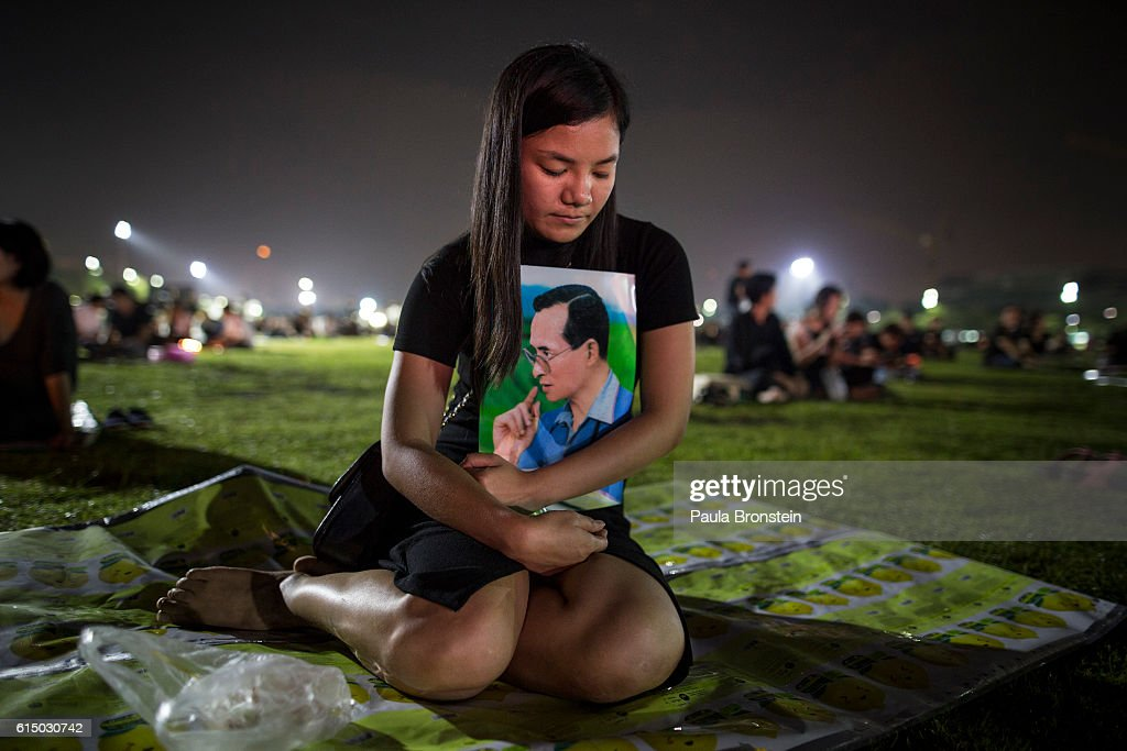 Thai's pray and light candles in memory of the late King of Thailand outside the Grand Palace on October 16, 2016 in Bangkok, Thailand. Thailand's King Bhumibol Adulyadej, the world's longest-reigning monarch, died at the age of 88 in Bangkok's Siriraj Hospital on Thursday after his 70-year reign. The Crown Prince Maha Vajiralongkorn had asked for time to grieve the loss of his father before becoming the next king as nation waits for the coronation date.