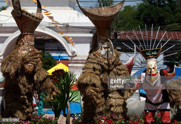 Thais wear masks representing the spirits of the dead springing back to life during the annual Phi Ta Khon or Ghost festival in Dan Sai Loei province...