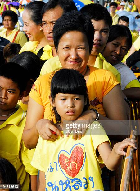Thais wearing yellow shirt gather to celebrate the 60th anniversary of Thai King Bhumibol Adulyadej's accession to the throne in front of the Ananda...