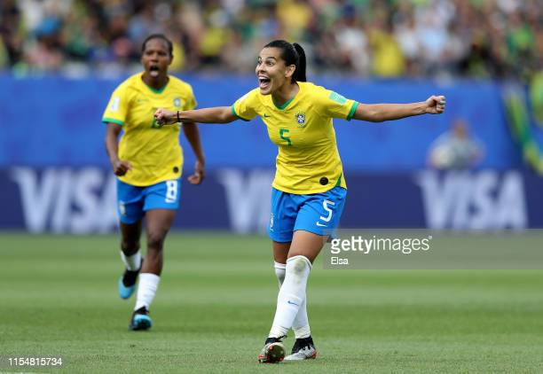 Thaisa and Formiga of Brazil celebrate teammate Cristiane's goal in the second half against Jamaica during the 2019 FIFA Women's World Cup France...