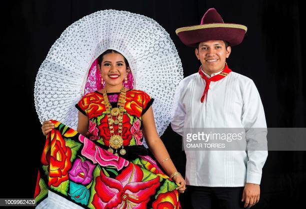 Thaisa Lopez and Felipe Lopez from Francisco Ixhuatan pose during a rehearsal for the Guelaguetza traditional festival in Oaxaca Mexico on July 29...