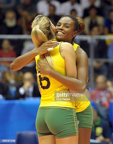 Thaisa Menezes and Fabiana Claudino of Brazil celebrate victory after the FIVB Women's World Championship pool Brankica Mihajlovic of Serbia B match...