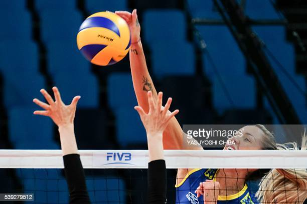 Thaisa Menezes of Brazil spikes the ball against Japan during FIVB Women's volleyball world grand prix 2016 at Carioca Arena of the Olympic Park in...