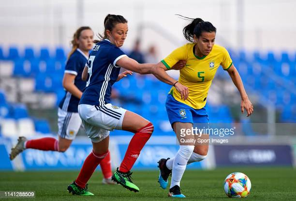 Thaisa Moreno of Brazil competes for the ball with Caroline Weir of Scotland during the Women's International friendly match between Brazil and...
