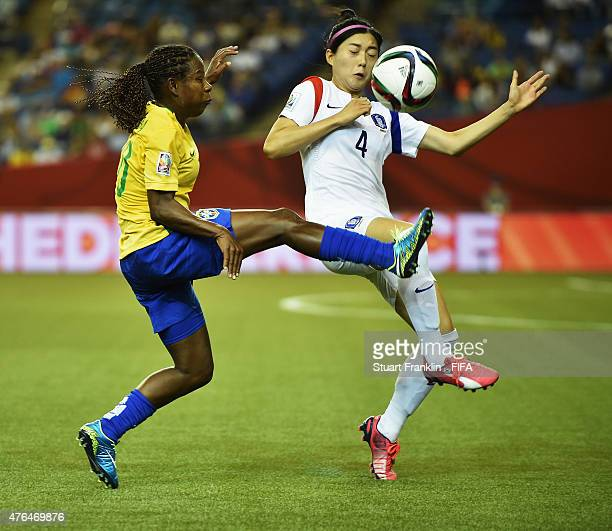 Thaisa of Brazil is challenged by Seoyeon Shim of Korea during the FIFA Women's World Cup 2015 group E match between Brazil and Korea Republic at...