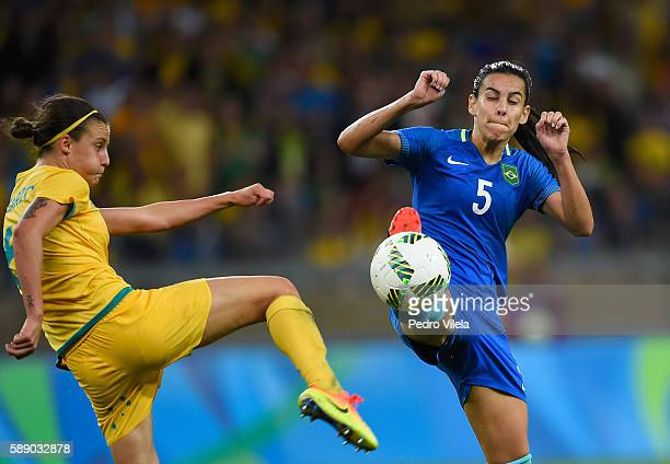 Thaisa of Brazil kicks the ball against Chloe Logarzo of Australia during the second half of the Women's Football Quarterfinal match at Mineirao...