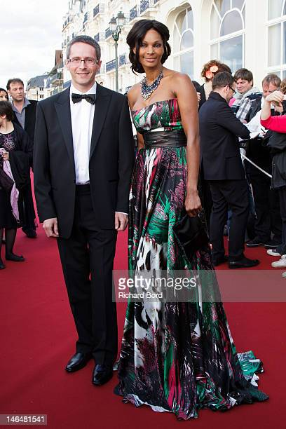 Thales Angenieux CEO Pierre Andurand and Angenieux's model Linda Carriel attends the 26th Cabourg Romantic Film Festival on June 16 2012 in Cabourg...