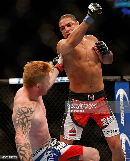 Thales Leites knocks down Ed Herman in their middleweight bout during the UFC 167 event inside the MGM Grand Garden Arena on November 16 2013 in Las...