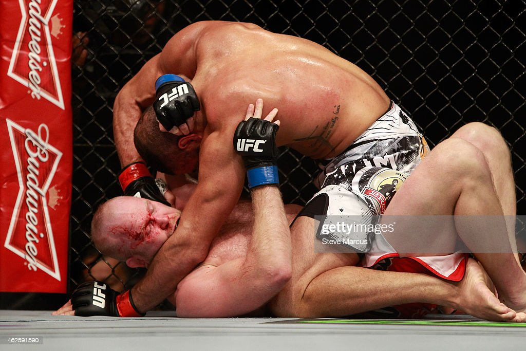 Thales Leites (top) punches Tim Boetsch in their middleweight bout during UFC 183 at the MGM Grand Garden Arena on January 31, 2015 in Las Vegas, Nevada. Leites won by submission in the second round.