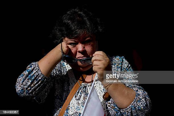 Thalidomide victim puts her sunglasses on after the first day of a trial involving the German pharmaceutical company Gruenenthal which produced the...