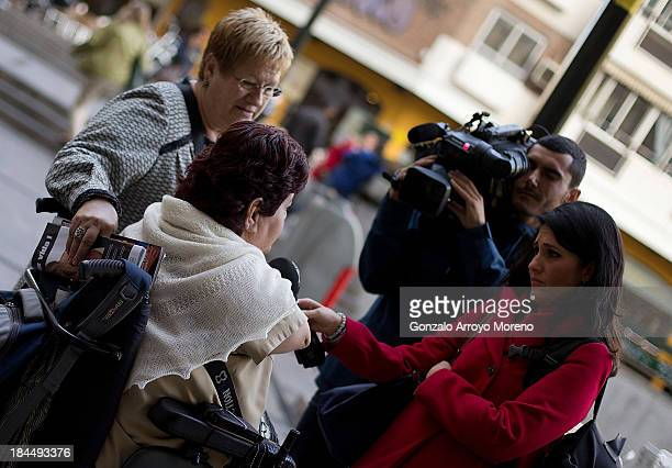Thalidomide victim speaks to members of the media with her mother after the first day of a trial involving the German pharmaceutical company...