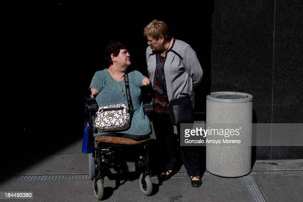 Thalidomide victim speaks with her mother outside the court after the first day of a trial involving the German pharmaceutical company Gruenenthal...
