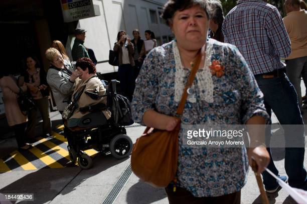 Thalidomide victims gather outside the court after the first day of a trial involving the German pharmaceutical company Gruenenthal which produced...