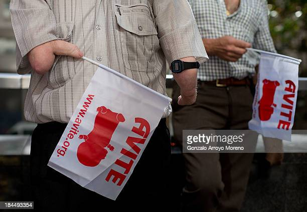 Thalidomide victims hold AVITE flags after the first day of a trial involving the German pharmaceutical company Gruenenthal which produced the drug...