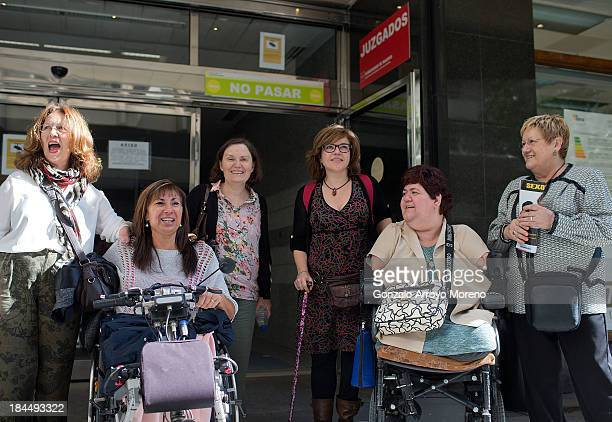 Thalidomide victims pose for members of the media with their relatives outside the court after the first day of a trial involving the German...