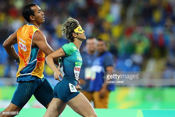 Thalita Vitoria Simplicio da Silva of Brazil competes in the Women's 400m T11 heats during day 8 of the Rio 2016 Paralympic Games at the Olympic...