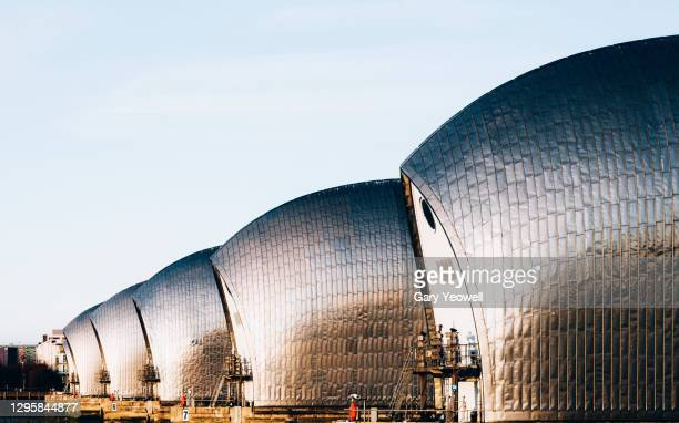 thames barrier at sunset - horizon over land stock pictures, royalty-free photos & images